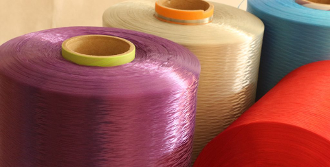 Multiple spools of colorful Polyester Yarn fibers supplied by SageZander